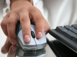 A hand on a computer mouse